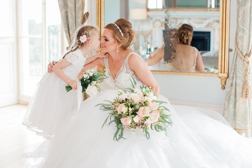 Bride with her flower girl in the Drawing Room at Rockbeare Manor
