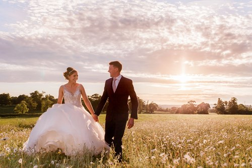 Bride and groom take a stroll at sun set, Rockbeare Manor wedding venue Devon