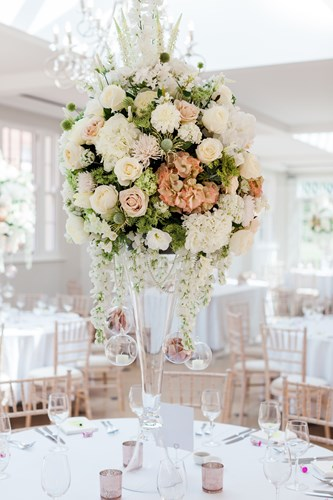 Stunning faux flower arrangements in the Ballroom at Rockbeare Manor, Exeter