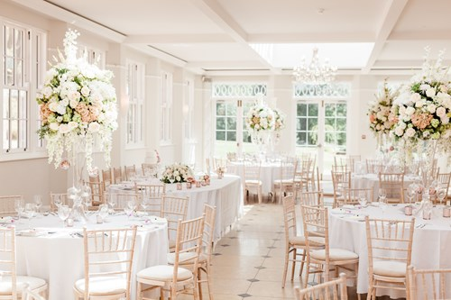 The Ballroom dressed with faux flower table centres at Rockbeare Manor