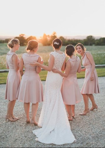 Bridesmaids Hug and Laugh Whilst Watching the Sunset