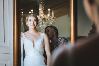 Beautiful Bride See's Herself in the Mirror her Wedding Dress for the First Time