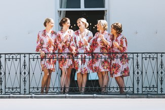 Bride and the Bridesmaids on the Balcony