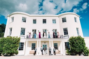 Bridal party on balcony at Devon wedding venue