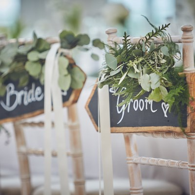 Bride and groom sign at Rockbeare Manor