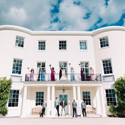 Guests on balcony after wedding at Rockbeare Manor during covid-19 pandemic