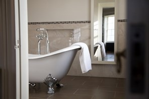 Freestanding bath in bedroom one at wedding venue in Devon Rockbeare Manor